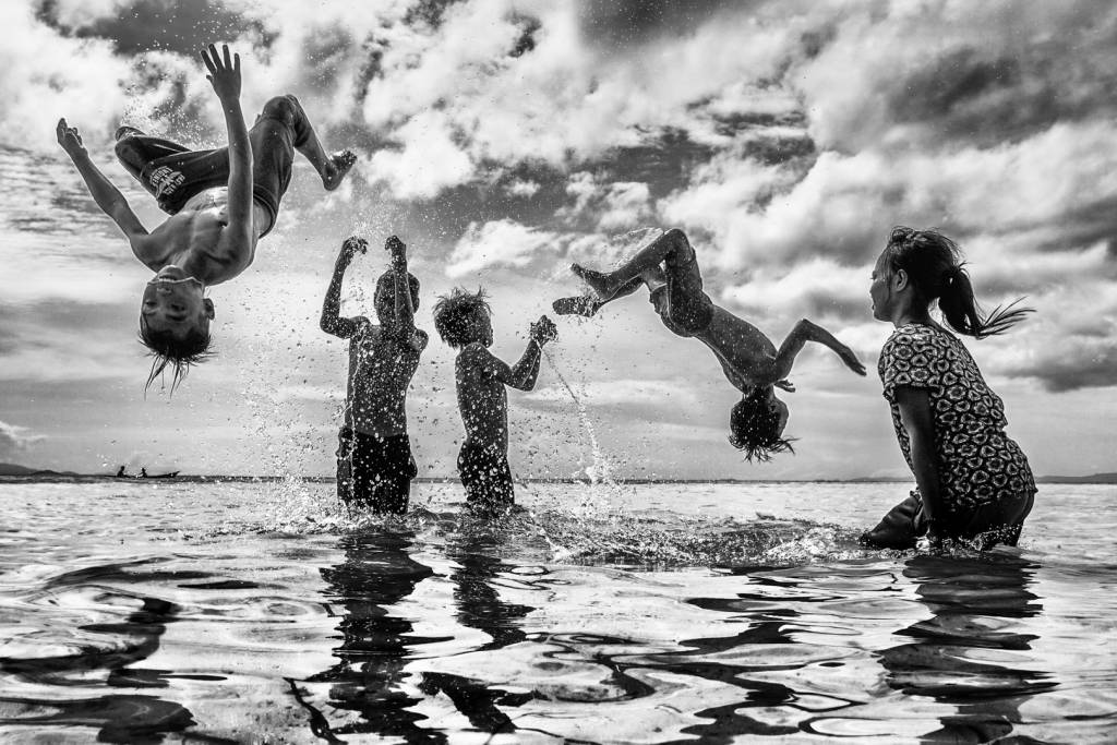 1Chin Leong Teo_Children Happy Jump BW 4_Bekkalokket Photoclub Gold medal__Projected Digital Images Open Monochrome